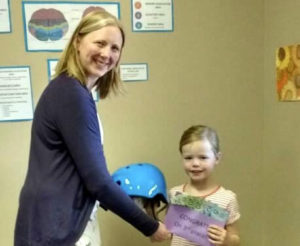 Kinley Receiving Her Prize - 3rd Place 2018 Happy Helmet Contest