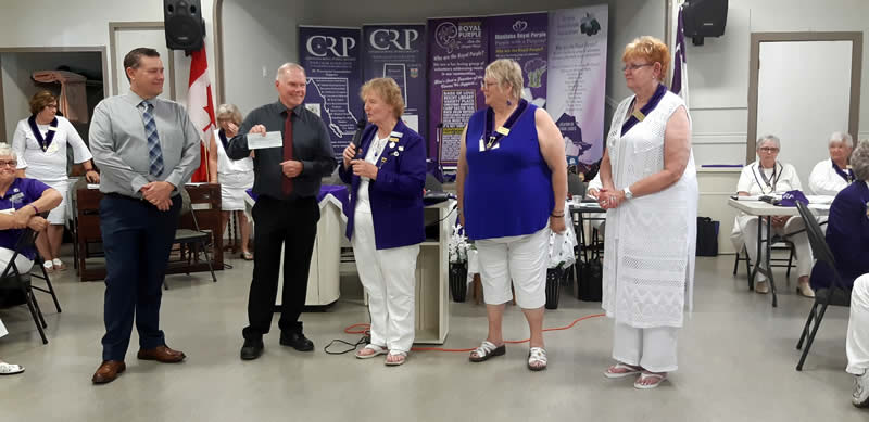 "Canadian Royal Purple BC, presenting a cheque for $3100.00. Funds were raised via the ""walk around the block for brain injury"" 2019 campaign to NBIA Board President Mr. Doug Jones."
